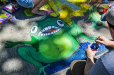 Free Man Painting Green Frog On Ground Stock Photos - 117112403