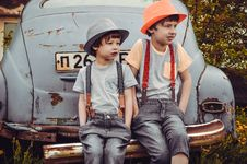 Free Two Boys Sitting On Vehicle Bumper Stock Image - 117112421