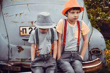 Free Two Boys Wearing Gray Shirts Sitting On Gray Vehicle Bumper Stock Image - 117112431