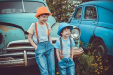 Free Two Boys Leaning On Classic Teal Vehicle Royalty Free Stock Image - 117112436