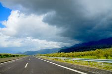 Free Photo Of Road Near Green Leaf Trees Under Dark Clouds At Daytime Royalty Free Stock Photo - 117112505