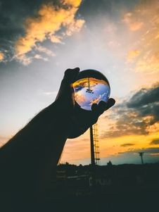 Free Person Holding Glass Ball Royalty Free Stock Image - 117112516