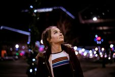 Free Woman Looking Up During Night Time Stock Images - 117112624