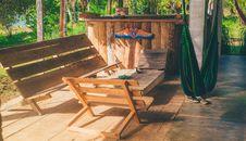 Free Green Hammock Near Wooden Patio Set Stock Image - 117112641