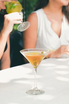 Free Clear Cocktail Glass Filled With Liquor On White Table Stock Photos - 117112693