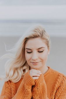 Free Blonde Haired Woman In Orange Knitted Long-sleeved Top Stock Images - 117112784