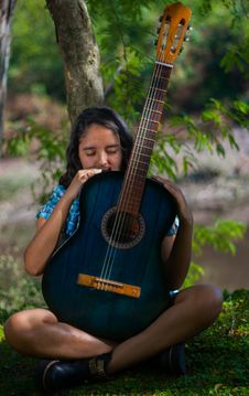 Free Woman Holding Blue Classical Guitar Stock Photography - 117280642