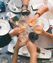 Free Group Of People Holding Wine Glasses Royalty Free Stock Images - 117352439