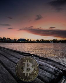 Free Body Of Water During Dawn With Bitcoin Logo Text Overlay Royalty Free Stock Photo - 117352465