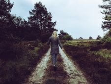 Free Woman In Grey Cardigan With Grey And Black Striped Pants Walking At The Pathway Stock Images - 117352494