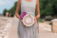 Free Woman Wearing White And Black Striped Sleeveless Dress Holding Round Crochet Bag Royalty Free Stock Photography - 117352507