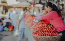 Free Selective Focus Photography Of Woman Wearing Red Hoodie Standing Behind Of Basket Full Of Fruits Royalty Free Stock Images - 117352539