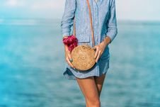 Free Woman Wearing Blue Long-sleeved Button-up Dress And Brown Sling Bag Stock Photos - 117352543