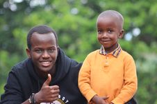 Free Man Wearing Black Hoodie Beside Boy Wearing Orange Long-sleeved Polo Shirt Royalty Free Stock Image - 117352576