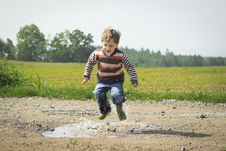 Free Boy Jumping Near Grass At Daytime Stock Photography - 117352672