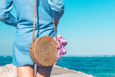 Free Woman Wearing Blue And White Striped Dress With Brown Rattan Crossbody Bag Near Ocean Royalty Free Stock Images - 117352679
