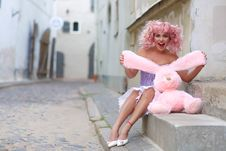 Free Woman Wearing Purple And Pink Dress Holding Rabbit Plush Toy Stock Image - 117352751