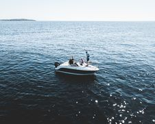 Free Three Person On White Motorboat At Daytime Royalty Free Stock Photos - 117352838