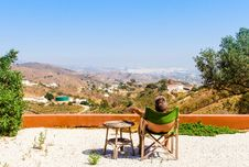 Free Man Sitting On Green Chair Near Trees And Mountain Under Blue Sky At Daytime Royalty Free Stock Image - 117352906