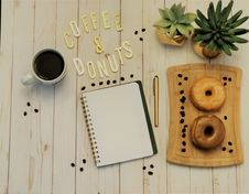 Free Spiral Notebook Beside Pen And Plants Stock Images - 117420854