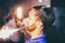 Free Person Holding Fireworks By Mouth Stock Photo - 117420870