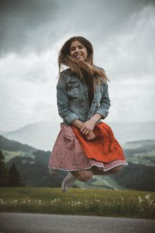 Free Woman In Blue Denim Jacket Jumping Royalty Free Stock Photography - 117420897