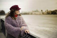 Free Woman Wearing Purple Fleece Coat Standing Beside Black Metal Fence Near Body Of Water Stock Images - 117420984