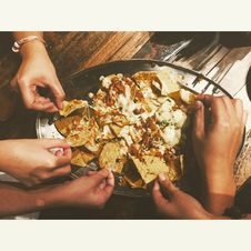 Free Close-up Photography Of People Picking Nachos Chips Stock Image - 117420991