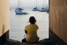 Free Woman In Yellow Shirt Sitting Near Body Of Water Royalty Free Stock Images - 117486179