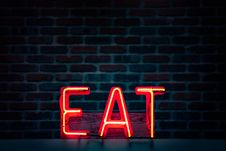 Free Red Eat Neon Sign Turned On Stock Photography - 117486362