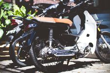 Free White Underbone Motorcycle Parked Beside A Motorcycle Royalty Free Stock Images - 117536889