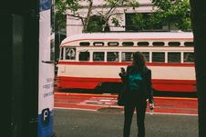 Free Woman Wearing Black Blazer Beside White And Red Cable Cab Stock Photography - 117608432