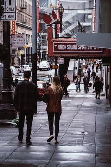 Free Man And Woman Walk Beside Store Royalty Free Stock Photo - 117608435