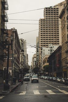 Free Cars On Street Surrounded By Buildings Under Dark Sky Royalty Free Stock Photos - 117608508