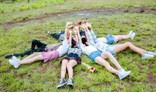 Free Group Of Friends Form In Circle While Lying On The Grass While Hands On Top Stock Images - 117608524