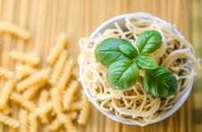 Free Pasta Noodles With Fresh Basil Leaves Royalty Free Stock Image - 117688956