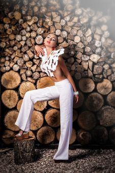 Free Woman Wearing White Crop-top Standing Beside Tree Slabs Stock Images - 117689014