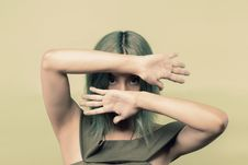 Free Woman Wearing Green Sleeveless Top Covering Her Face But Eyes With Both Hands Royalty Free Stock Photography - 117689087