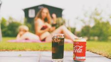 Free Coca-cola Can And Drinking Glass Filled With Coke Stock Images - 117689094