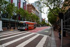 Free Red And Gray Passenger Bus Near High-rise Building Stock Images - 117689144