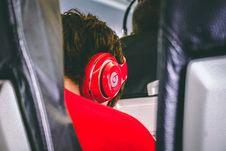 Free Man Wearing Red Beats By. Dre Headphones Royalty Free Stock Photo - 117689225