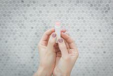 Free Person Holding A Lip Balm Stock Photos - 117689253