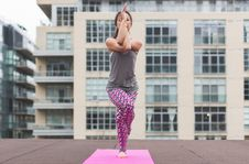 Free Woman In Gray Top And Pink Pants Yoga On Pink Mat Royalty Free Stock Photos - 117689308