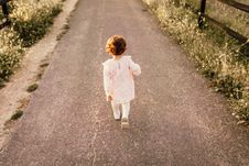 Free Girl Wearing White Clothes Walking On Pavement Road Stock Image - 117689321