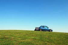 Free Blue Hatchback On Green Grass Field Under Blue Sky Royalty Free Stock Photos - 117767838