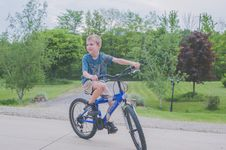 Free Boy Riding Bicycle Stock Photos - 117767843