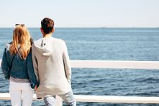 Free Man And Woman Beside Wooden Hand Rail Beside Body Of Water Royalty Free Stock Photos - 117768108