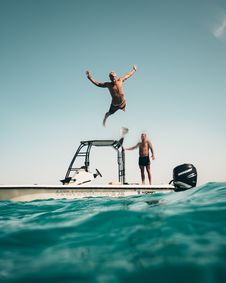 Free Photo Of Man Jumping From Boat To The Sea Royalty Free Stock Photo - 117852765