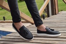 Free Person Wearing White-and-black Leather Slip-on Shoes With Tassels Royalty Free Stock Images - 117852789