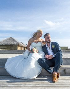 Free Woman Wearing White Wedding Gown Sitting Near Man Wearing Black Suit Jacket And Pants Royalty Free Stock Images - 117852869